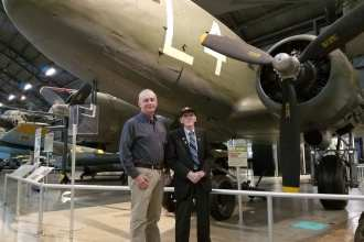 "Air Force Research Laboratory Aerospace Systems Directorate employee Kevin Price (left) and World War II veteran Jim ""Pee Wee"" Martin look over the C-47 aircraft displayed at the National Museum of the United States Air Force on August 30, 2019. Price will accompany the 98-year-old Martin in September as he travels to the Netherlands to parachute into the region he helped liberate 75 years ago as part of Operation Market Garden. (U.S. Air Force Photo/Holly Jordan)"