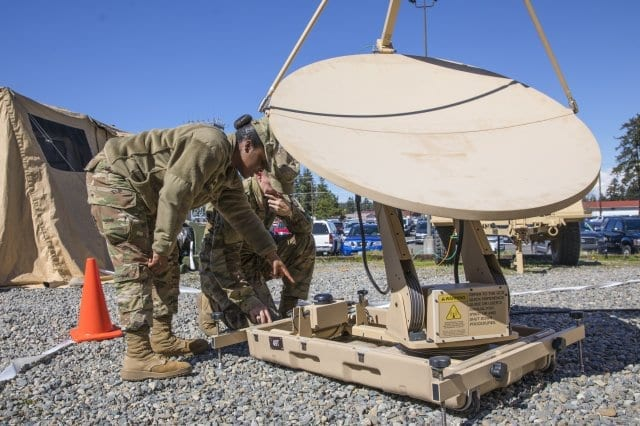 Spc. Desteni Noorfleet and Pvt. Bobby Wilson set up a satellite during the Joint Warfighting Assessment on Joint Base Lewis-McChord, Wash., Apr. 29, 2019. The Joint Warfighting Assessment was designed to assess multi-domain operations concepts, capabilities, and formations at echelon in order to provide critical insights and feedback on the Army modernization efforts. (Photo Credit: Spc. Audrey Ward)