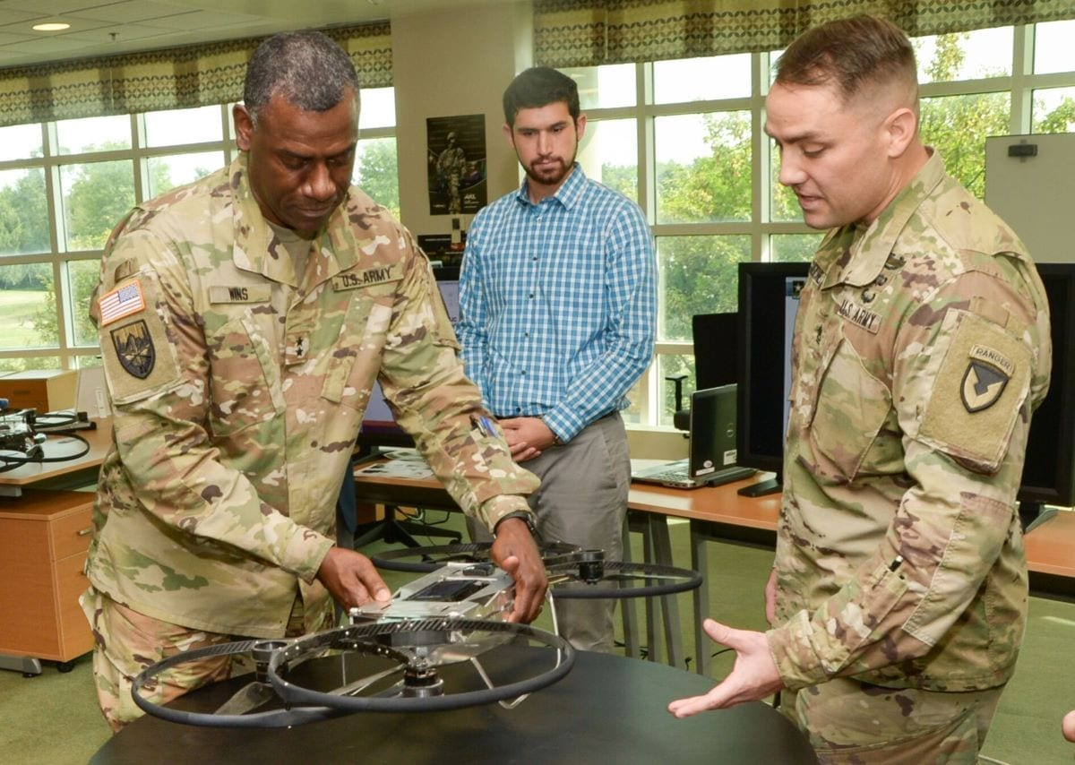 """Maj. Gen. Cedric T. Wins (left), commanding general of the U.S. Army Combat Capabilities Development Command, learns about a prototype version of the Joint Tactical Aerial Resupply Vehicle, or JTARV, from Sgt. 1st Class Daniel Guenther (right), an enlisted advisor at the Army Research Laboratory Weapons and Materials Research Directorate, during a visit at Aberdeen Proving Ground, Maryland. Also known as the """"hoverbike,"""" the JTARV may one day enable soldiers on the battlefield to order resupply and then receive those supplies rapidly from an autonomous unmanned aerial vehicle."""