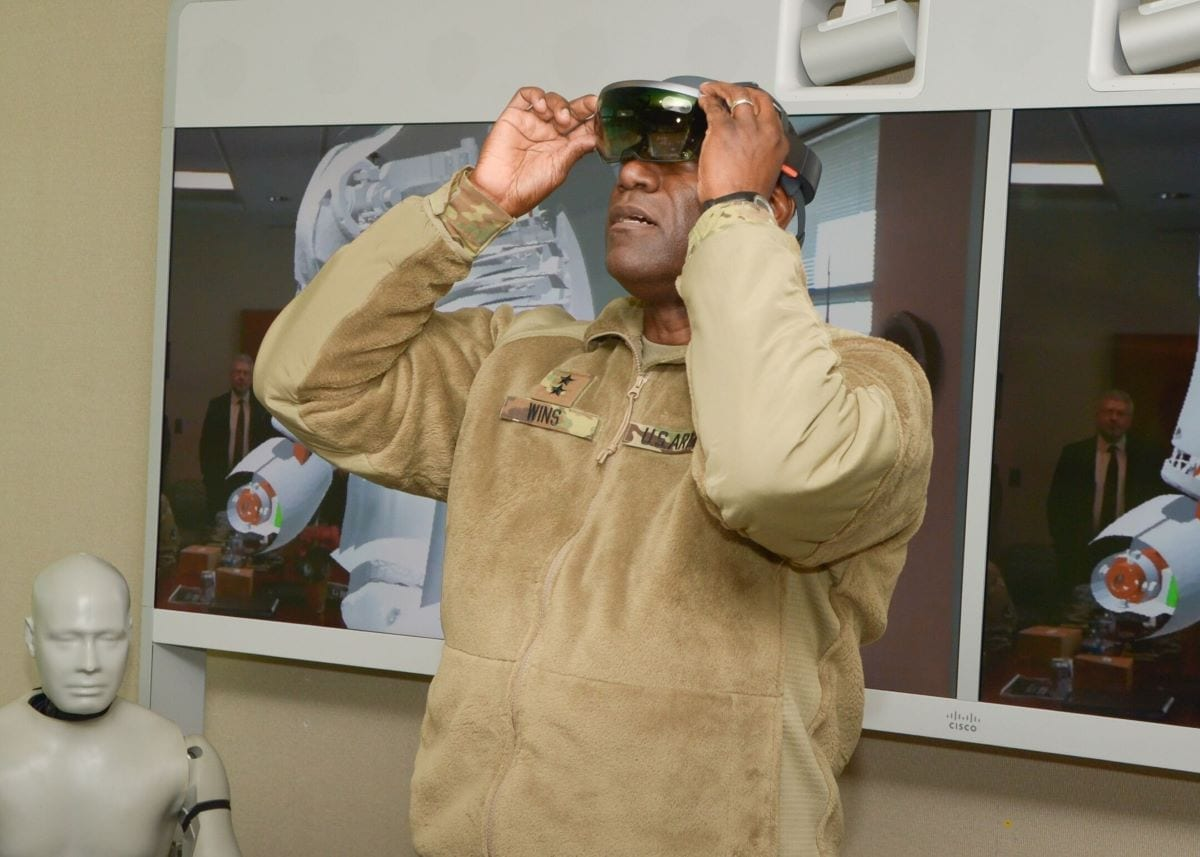 CCDC Commander Maj. Gen. Cedric T. Wins dons advanced holographic glasses– the Hololens from Microsoft. Researchers use the glasses to virtually explore simulations and gain new understanding of how blast injuries affect soldiers.