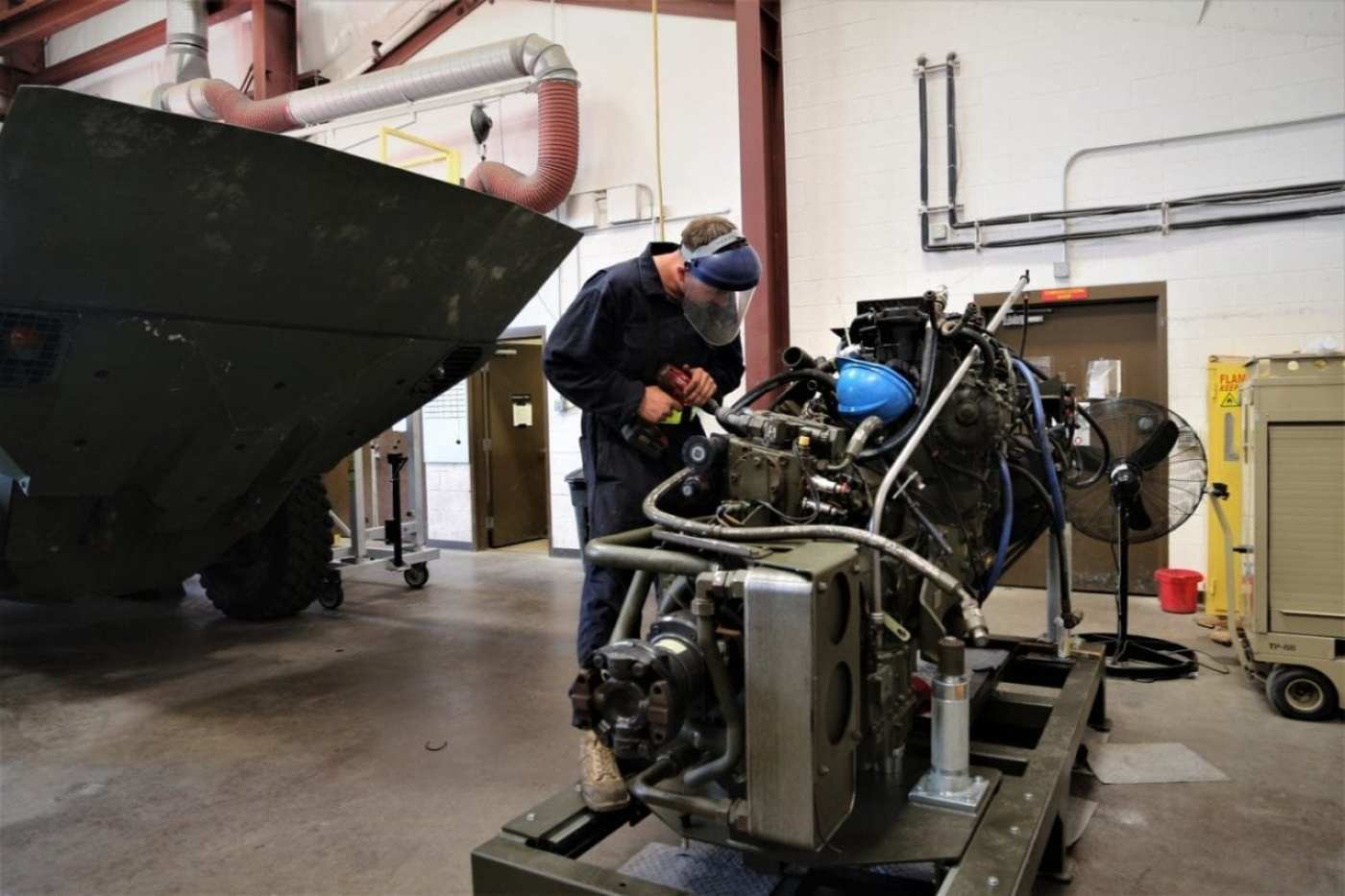 Sgt. Jarrod Warren performs preventative maintenance checks and services on an engine of the Amphibious Combat Vehicle during the logistics demonstration on Sept. 10, 2019, at Camp Pendleton, California. Log Demo is designed to evaluate and correct, if needed, the maintenance and operational manuals for the ACV that will be eventually used by fleet Marines. (U.S. Marine Corps photo by Ashley Calingo)