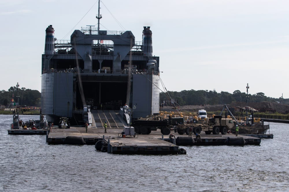 Army shipping transport vehicles refueling military transportation shipping transit logistics containers aircraft boats rail trains commercial partners