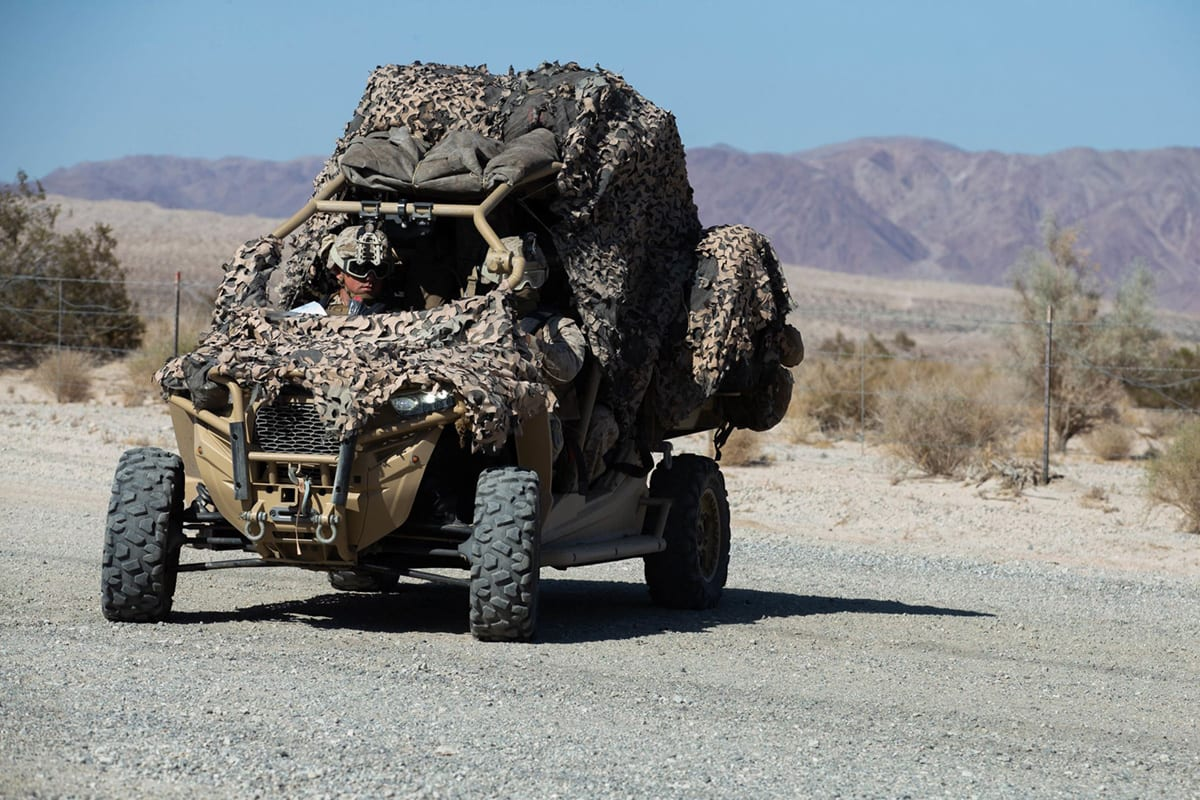 U.S. Marines with Security Forces, Division Combat Skills Company (DCSC), Headquarters Battalion, Second Marine Division (2d MARDIV) establish route security with a Utility Tactical Vehicle at Camp Wilson, Marine Air Ground Combat Center, Twentynine Palms, California, Oct. 14, 2019. (U.S. Marine Corps photo by Lance Cpl. Jesse Carter-Powell)