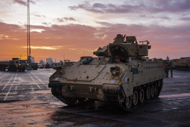 An Army M2 Bradley with 1st Armored Brigade Combat Team, 1st Infantry Division, is loaded onto a Roll-on Roll-off Carrier (Ro-Ro) vessel, at the port of Bremerhaven, Germany Oct. 18, 2019. The Big Red One Soldiers have been deployed throughout Eastern Europe for the last nine months as a rotational force in support of U.S. Army Europe and Atlantic Resolve. (U.S. Army photo by Sgt. Thomas Mort)