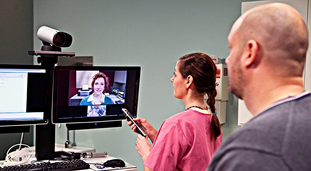 A veteran and a nurse interact with a provider using telehealth technology during a clinic visit. Telemedicine could potentially be implemented in areas that VA research identifies as having poor diabetes- related outcomes, whether due to neighborhood or workforce deprivation factors.