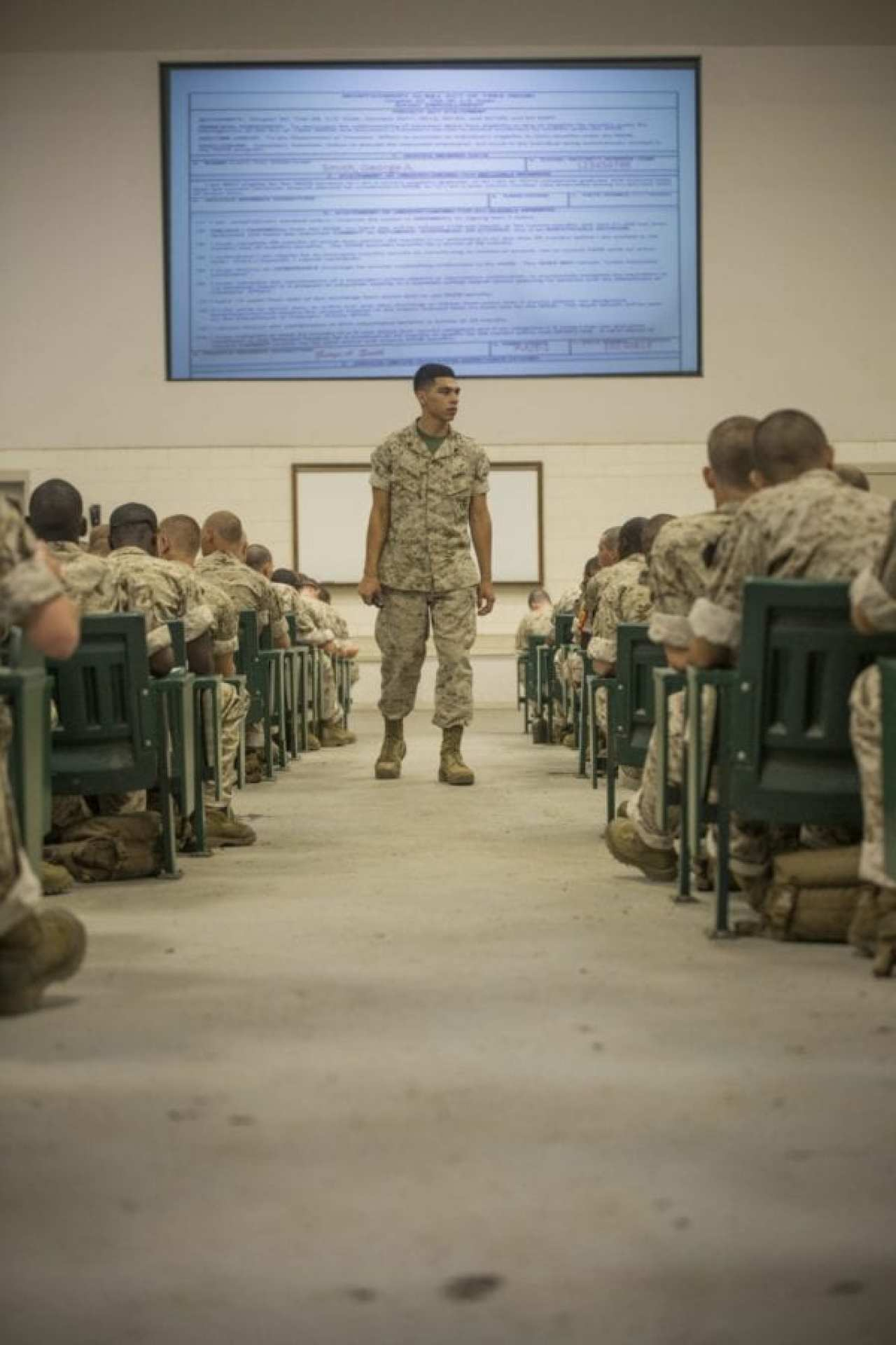 Cpl. Eduardo Villalobos, academic instructor, teaches recruits of Delta Company, 1st Recruit Training Battalion, about the various tuition assistance programs available, such as the Post-9/11 G.I. Bill and the Montgomery G.I. Bill on Aug. 26, 2015, on Parris Island, South Carolina. The class covered the benefits and differences between each G.I. Bill.