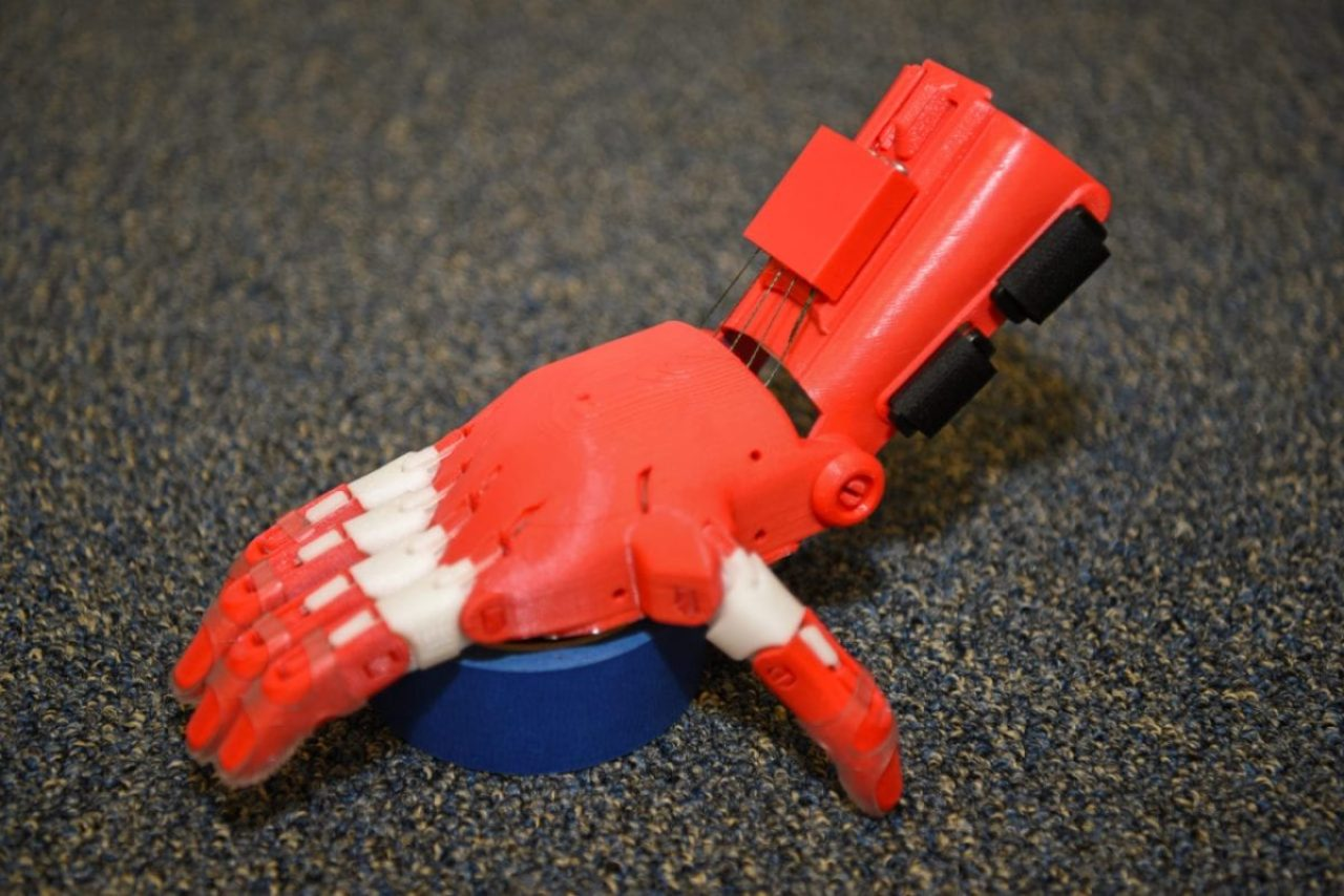 "A prosthetic 3-D printed hand is made by Tech Stg. Zachary Zilm, 582nd Operation Support Squadron NCO in charge of group training, July 3, 2018, on F.E. Warren Air Force Base, Wyoming Zilm works through the organization Enabling the Future, a global network of passionate volunteers using 3-D printing to give the world a ""helping hand"". The hands go to children who do not have the option for traditional prosthetic devices. Additive- or 3-D printing and the ways it can potentially be used to improve care for patients with prosthesis is of great interest to the VA."
