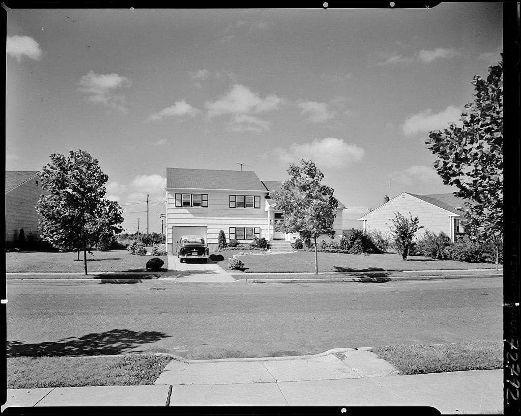 A home in the suburb of Levittown, New York. The G.I. Bill provided veterans with access to federally guaranteed home, farm, and business loans with no down payment, enabling millions to purchase homes outside dense urban areas.