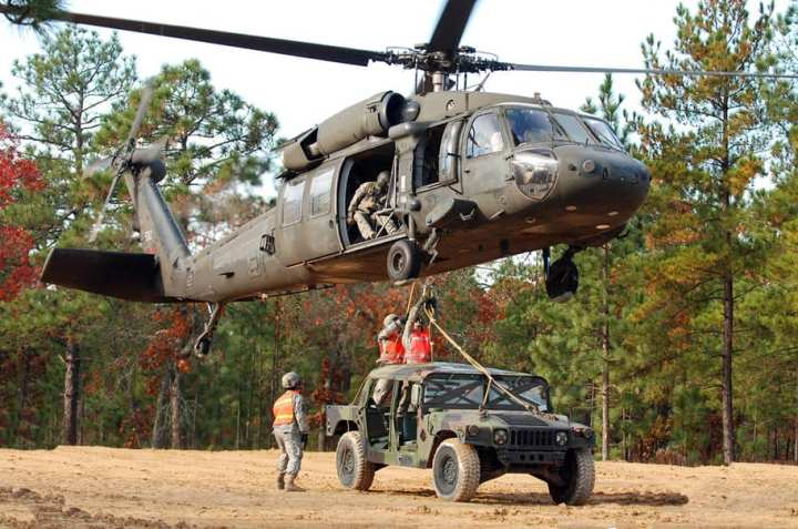 Army National Guard Helicopter Lifts HUMVEE