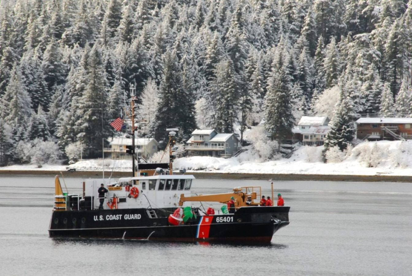 Crew members aboard the Coast Guard Cutter Elderberry, a 65-foot inland buoy tender homeported in Petersburg, Alaska, prepare buoys to be set in the Gastineau Channel.
