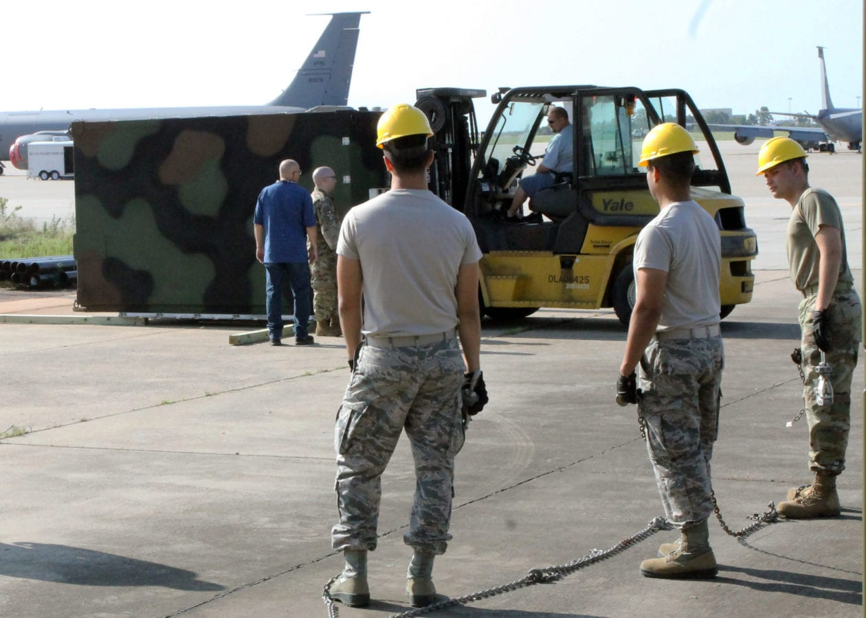 Airmen from the 752nd Operations Support Squadron unload the AN/TYQ-23A Tactical Air Operations Module weapons system as it arrives at Tinker Air Force Base, Okla. in September 2019. (U.S. Air Force photo by 2nd Lt. Ashlyn K. Paulson)
