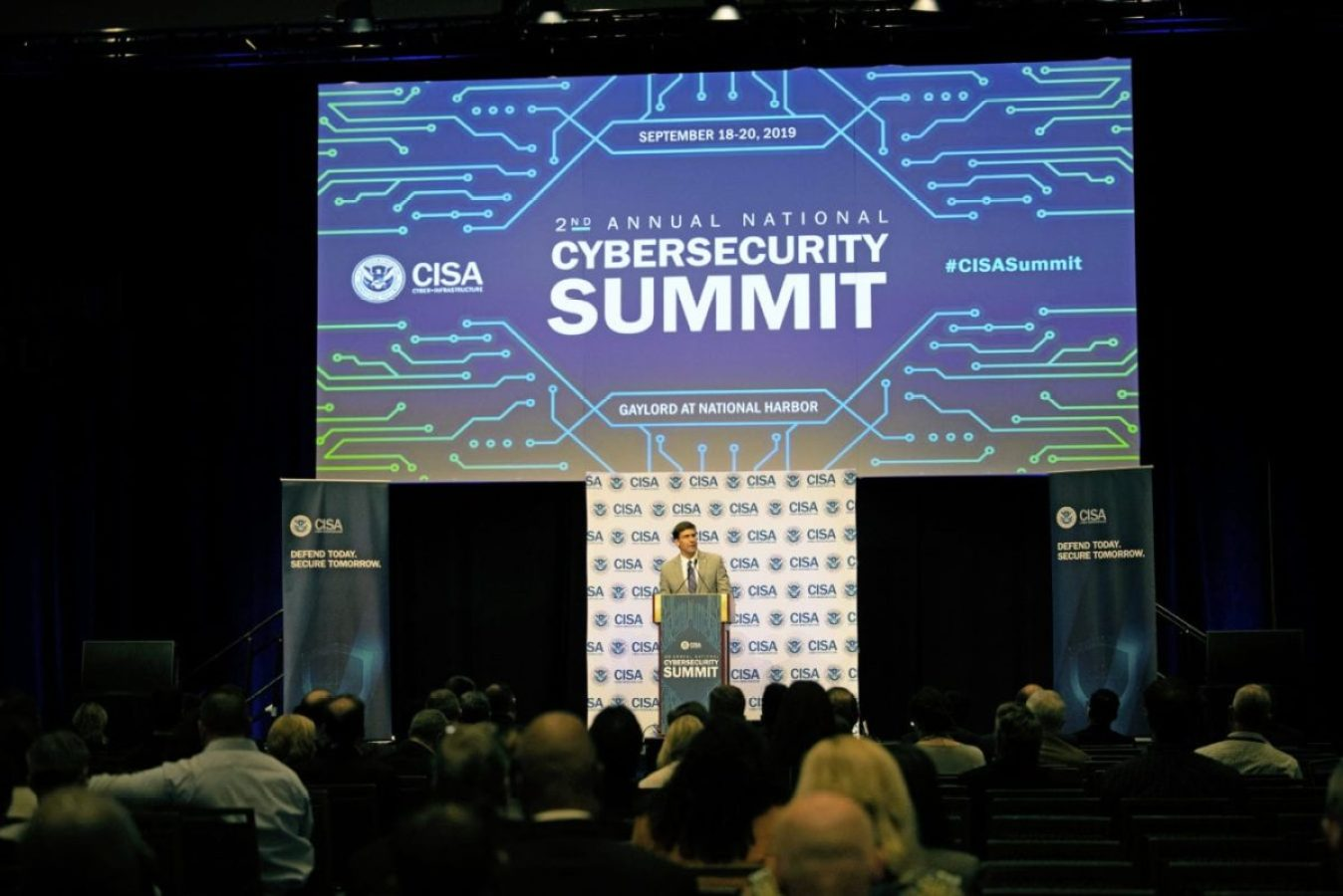 U.S. Secretary of Defense Dr. Mark T. Esper delivers remarks at the Department of Homeland Security (DHS) Cybersecurity and Infrastructure Security Agency's second annual national cybersecurity summit, National Harbor, Maryland, Sept. 19, 2019. As a part of DHS, the Coast Guard is subject to DHS efforts to upgrade and improve the security of IT infrastructure.