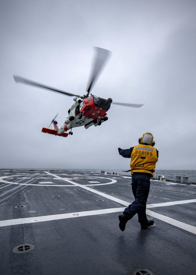 A U.S. Coast Guard MH-60T Jayhawk lands aboard the U.S. Navy destroyer USS Kidd during Exercise Northern Edge 2019.
