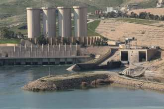 Mosul Dam, with its hydropower plant and four water storage towers, sits in a valley along the Tigris River 30 miles outside Mosul City in Iraq. It is the largest dam in Iraq and the fourth largest in the Middle East and supplies water, hydropower, irrigation, and flood control to the region. The governments of Iraq, Italy, and the United States have combined their efforts to stabilize Mosul Dam.Photo Courtesy of the Transatlantic Division