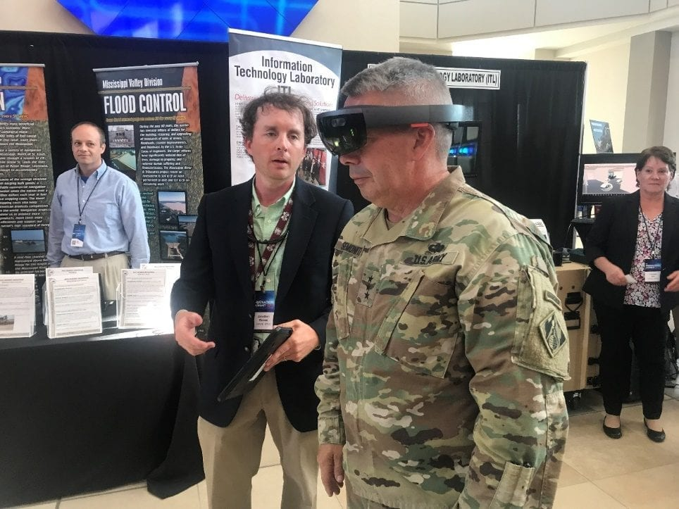 Lt. Gen. Todd Semonite tries out a set of virtual reality goggles at the Engineer Research and Development Center Innovation Summit. Semonite's Revolutionize effort involves significant use of technology to speed processing of information and quickly gather data during operations.