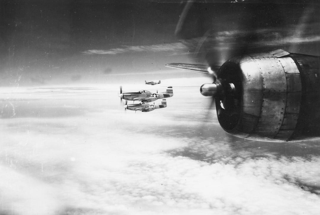 Captured airfields on Iwo Jima also permitted the P-51 Mustang to operate against the Japanese Home Islands escorting B-29s. These P-51s are tagging along with a B-29 Superfortress to navigate the long way back to their base at Iwo Jima in 1945.