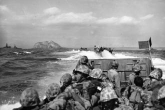 Landing Craft, Vehicle and Personnel (LCVP), and Landing Vehicles, Tracked (LVT) carry Marines to Iwo Jima on the day of the invasion. The great cost of the invasion and capture of Iwo Jima in Marine Corps casualties provoked controversy even while the war was still being waged.