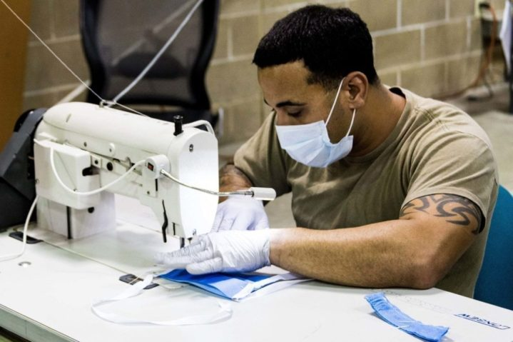 A parachute rigger with the 1st Special Forces Group's Group Support Battalion sews surgical masks for medical patients at Joint Base Lewis-McChord, Wash., March 31, 2020. (DoD image)