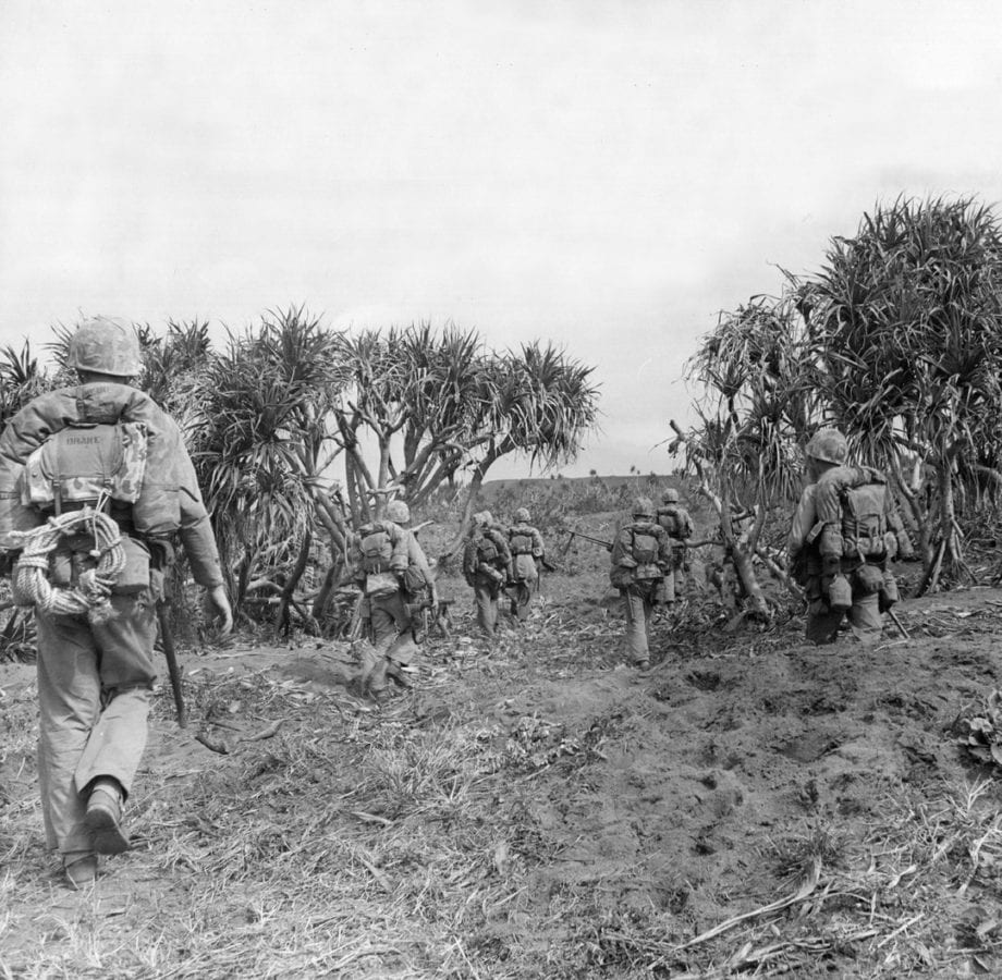An infantry battalion from the 3rd Marine Division moving up to the relief of another battalion during the fierce struggle for Iwo Jima. U.S. MARINE CORPS PHOTO