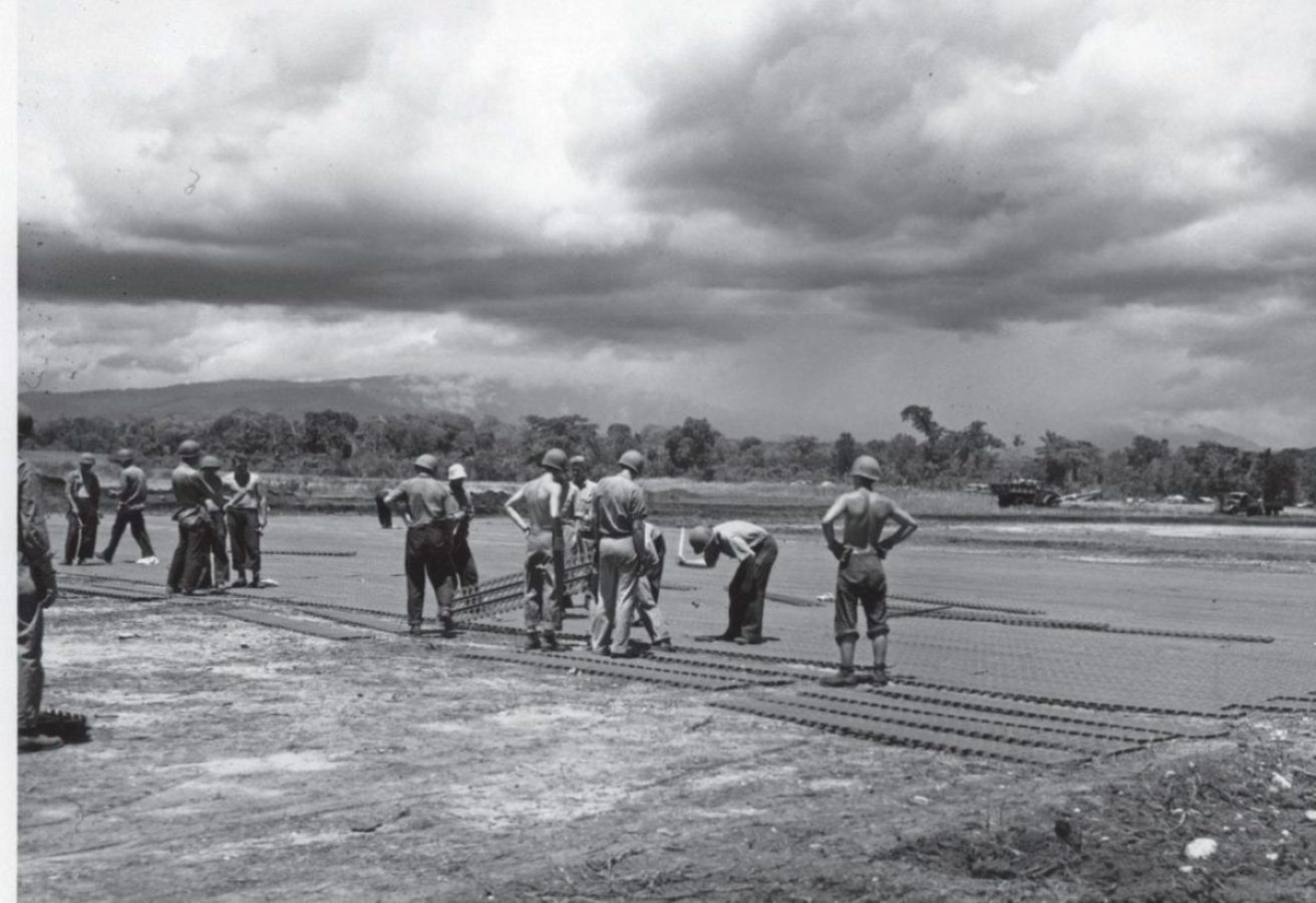 Seabees use Marston matting to make repairs and complete construction of the airstrip at Henderson Field in Guadalcanal in 1942. The Seabees and Army engineer battalions, and technologies like Marston matting, were key to constructing U.S. bases, supporting the advance across the Pacific. U.S. Naval History and Heritage Command Photo