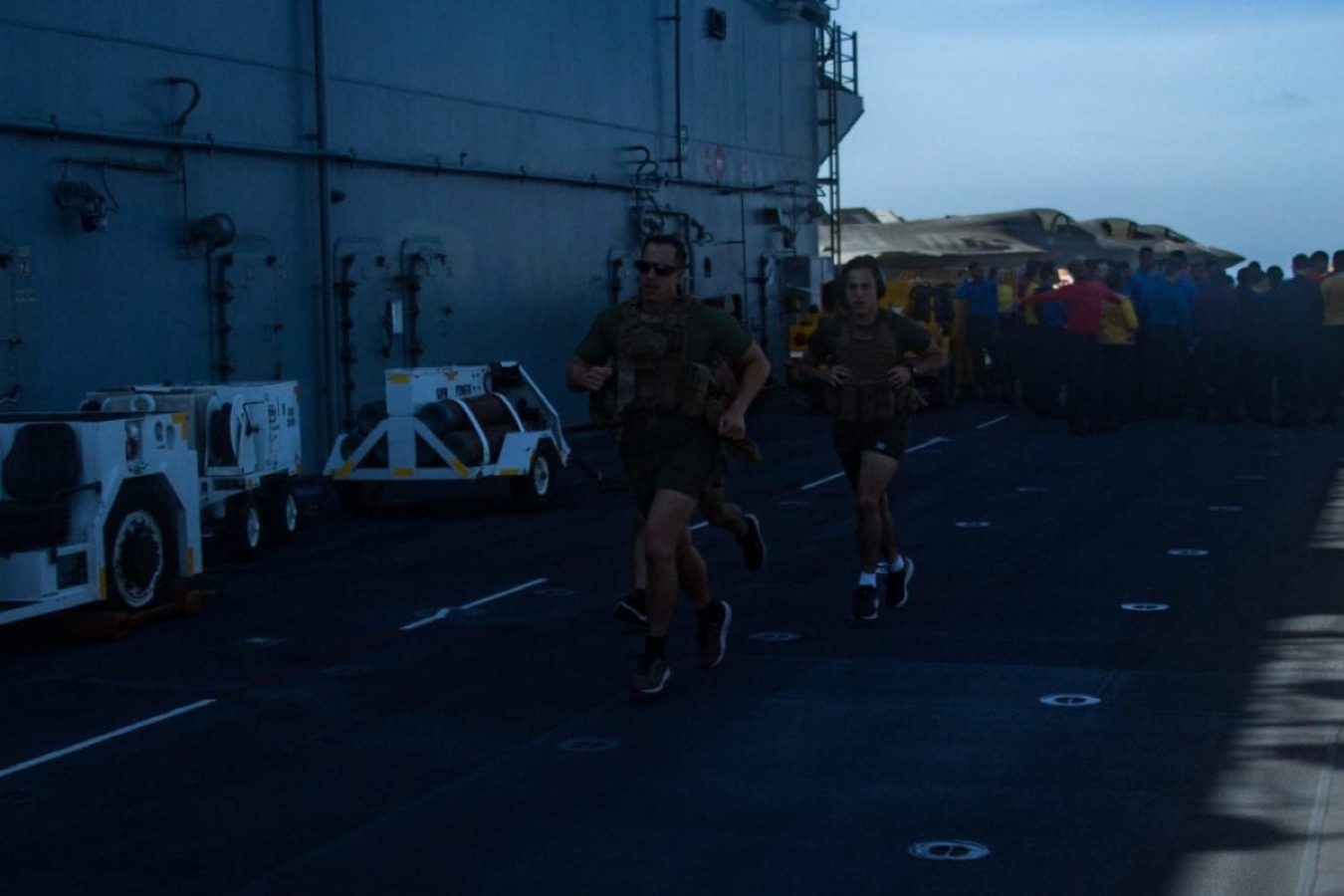 Marines with Battalion Landing Team, 1st Battalion, 5th Marines, 31st Marine Expeditionary Unit (MEU), participate in a 'Murph' workout challenge in memory of Gunnery Sgt. Diego Pongo and Capt. Moises Navas aboard amphibious assault ship USS America (LHA 6). (U.S. Marine Corps photo by Lance Cpl. Kolby Leger)