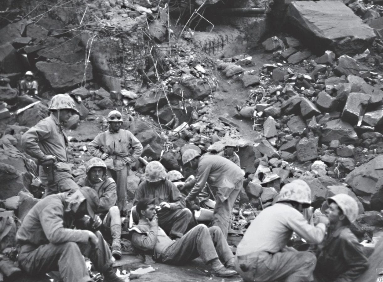 Sheltering in the rubble of a Japanese fortification, Marine casualties are given medical attention on Feb. 26, 1945, at an aid station in the cliffs near the East Boat Basin on Iwo Jima. U.S. MARINE CORPS HISTORICAL CENTER