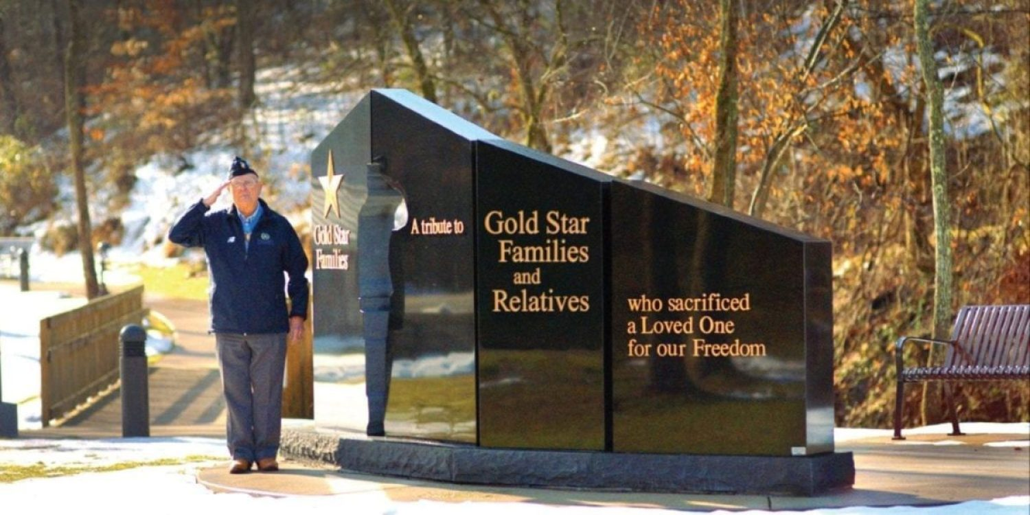 Williams with one of the Gold Star family monuments his foundation has built. PHOTO COURTESY OF HERSHEL WILLIAMS MEDAL OF HONOR FOUNDATION