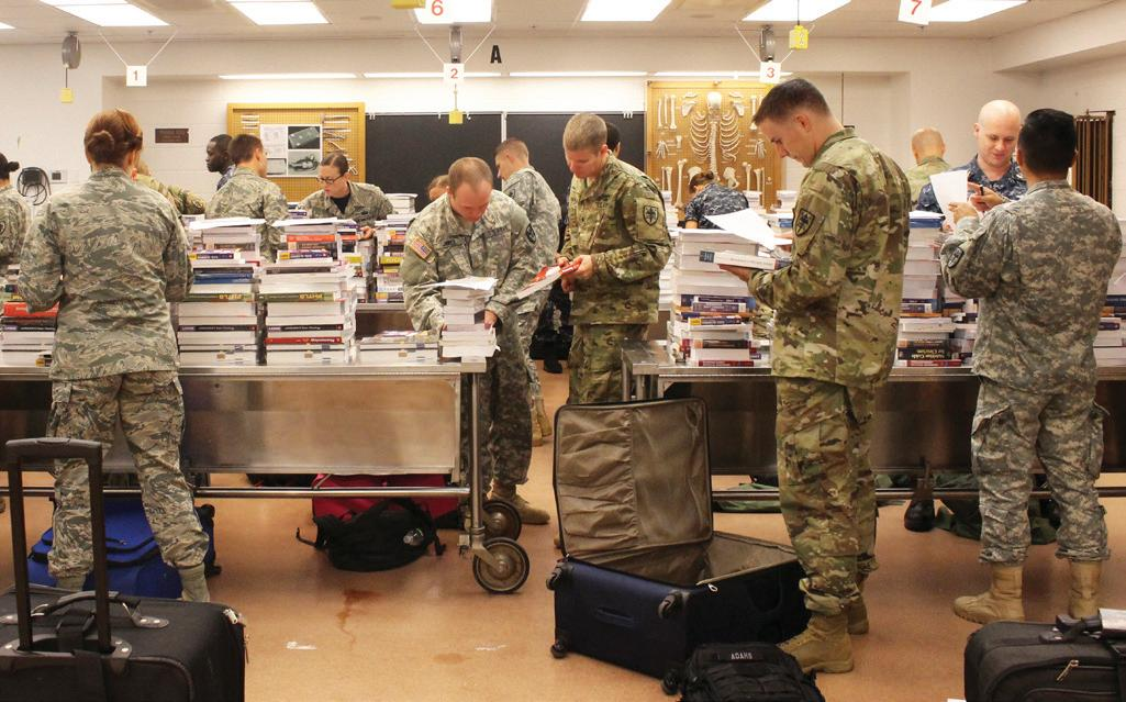 First-year medical students at USUHS's F. Edward Hébert School of Medicine receive more than 140 pounds of books each inside the school's anatomy lab in August 2016. USUHS educates, trains, and prepares uniformed services health professionals, officers, and leaders to directly support the Military Health System, U.S. national security and national defense strategies, and the readiness of the armed forces.