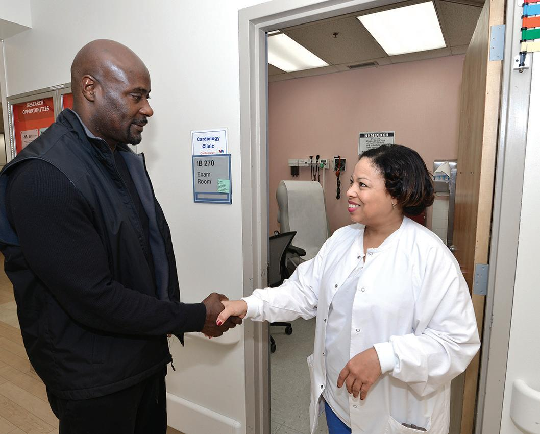 Veteran Cedric Boswell greets a nurse in the cardiology clinic at the Atlanta VA Medical Center. A study published in 2019 in the Journal of the American Medical Association found no statistically significant difference between private sector and VA wait times for cardiac specialty care.