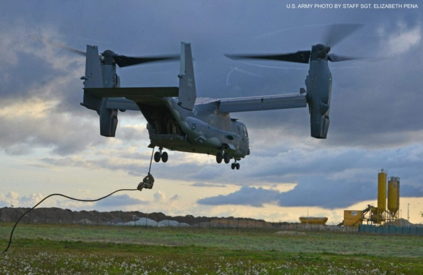Estonian special operations forces operator prepares to be hoisted up to a U.S. Air Force CV-22 Osprey