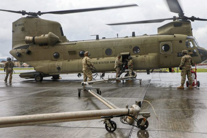 Petroleum Supply Specialists assigned to Echo Co. from 2nd Battalion, 25th Aviation Regiment and 3rd Battalion, 25th Aviation Regiment, work together to refuel three Black hawks and an Apache attack helicopter from 2-6 Cavalry Squadron, 25th Combat Aviation Brigade during training in Forward Arming and Refueling Point (FARP) procedures at Schofield Barracks, Hawaii Feb. 5, 2020. (U.S. Army photo by Sgt. Sarah D. Sangster)