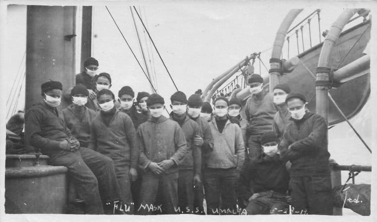 "Unalga's crew wearing ""Flu"" masks. All the cutter's crew members involved in the humanitarian effort volunteered to help. (NOAA)"