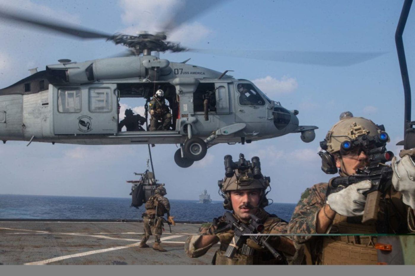 U.S. Marines with Reconnaissance Marines with the Maritime Raid Force, 31st Marine Expeditionary Unit (MEU) fast rope from a MH-60S Sea Hawk helicopter assigned to the Archangels of Helicopter Sea Combat Squadron (HSC) 25 Detachment 6 during a simulated visit, board, search, and seizure (VBSS) mission aboard dock landing ship USS Germantown (LSD 42). (U.S. Marine Corps photo by Sgt. Danny Gonzalez)