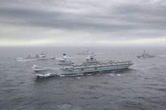 FULL UK CARRIER STRIKE GROUP ASSEMBLED FOR FIRST TIME