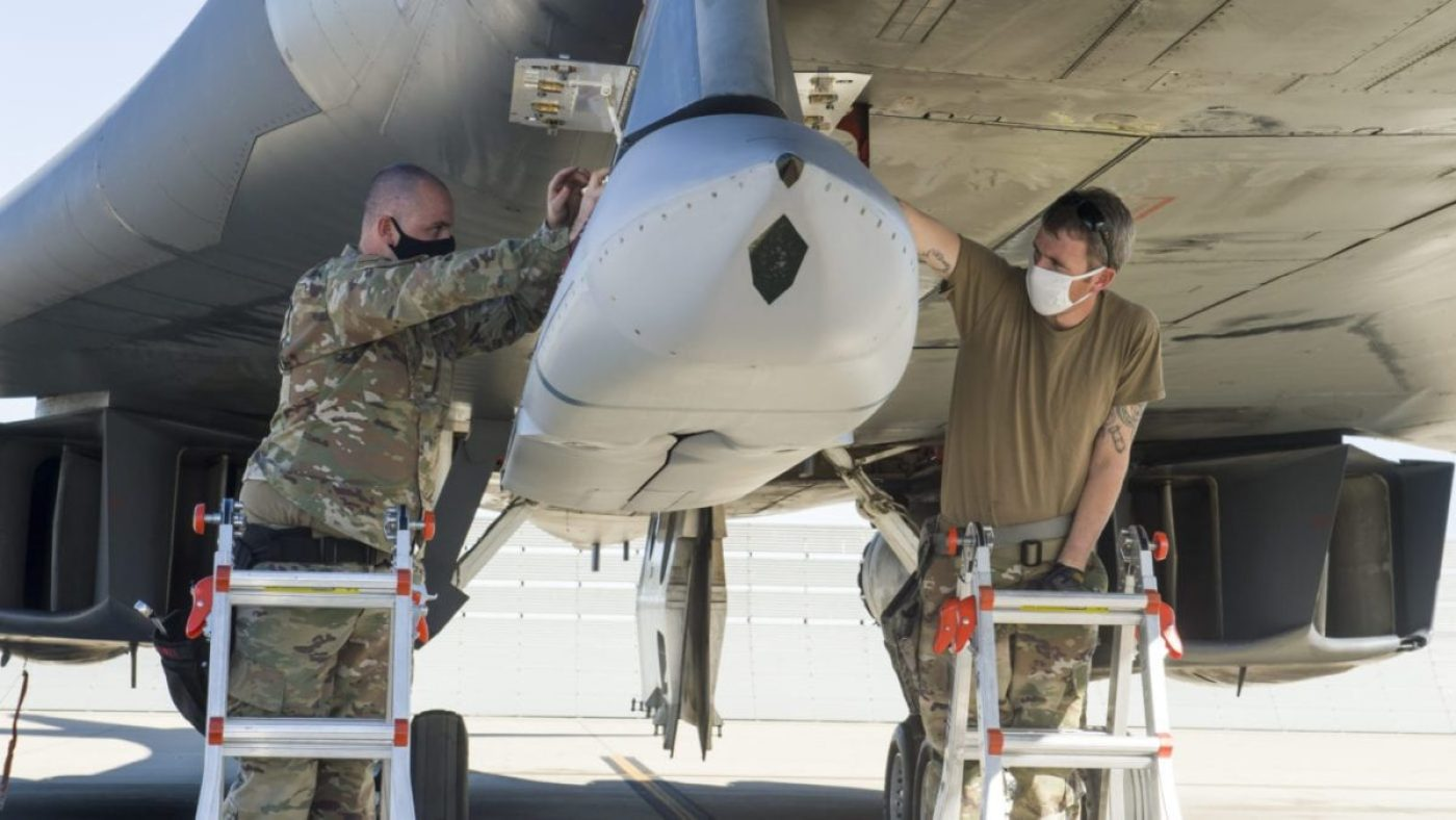 A weapon Loader crew uploads a Joint Air-to-Surface Standoff Missile to an external pylon on a B-1B Lancer at Edwards Air Force Base, California, Dec. 2. The Lancer successfully conducted an external release demonstration of the JASSM using the pylon in the skies over Holloman Air Force Base, New Mexico, Dec. 4. (Air Force photo by Joshua Miller)