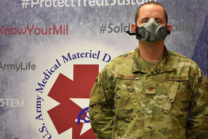 U.S. Air Force Maj. Daniel Williams demonstrates the fit of an N95 elastomeric half-mask respirator. Williams serves as product manager of the Warfighter Expeditionary Medicine and Treatment Project Management Office's N95 respirator efforts at the U.S. Army Medical Materiel Development Activity. (Photo by Jeffrey Soares, USAMMDA public affairs)