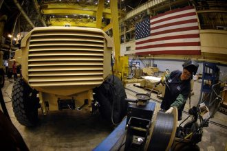A worker at Force Protection Industries makes a Cougar H 4 X 4 MRAP vehicle at the factory in Ladson, S.C., Jan. 18, 2008. (Photo by Cherie A. Thurlby, DOD/RELEASED)