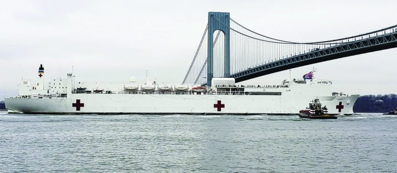 The U.S. Navy's Military Sealift Command hospital ship USNS Comfort arrived in New York City March 30 in support of COVID-19 response efforts. The USACE vessel Gelberman came alongside the ship's starboard side as it made its way along the New York Harbor to its newly dredged dock in Manhattan. (U.S. Army Photo)