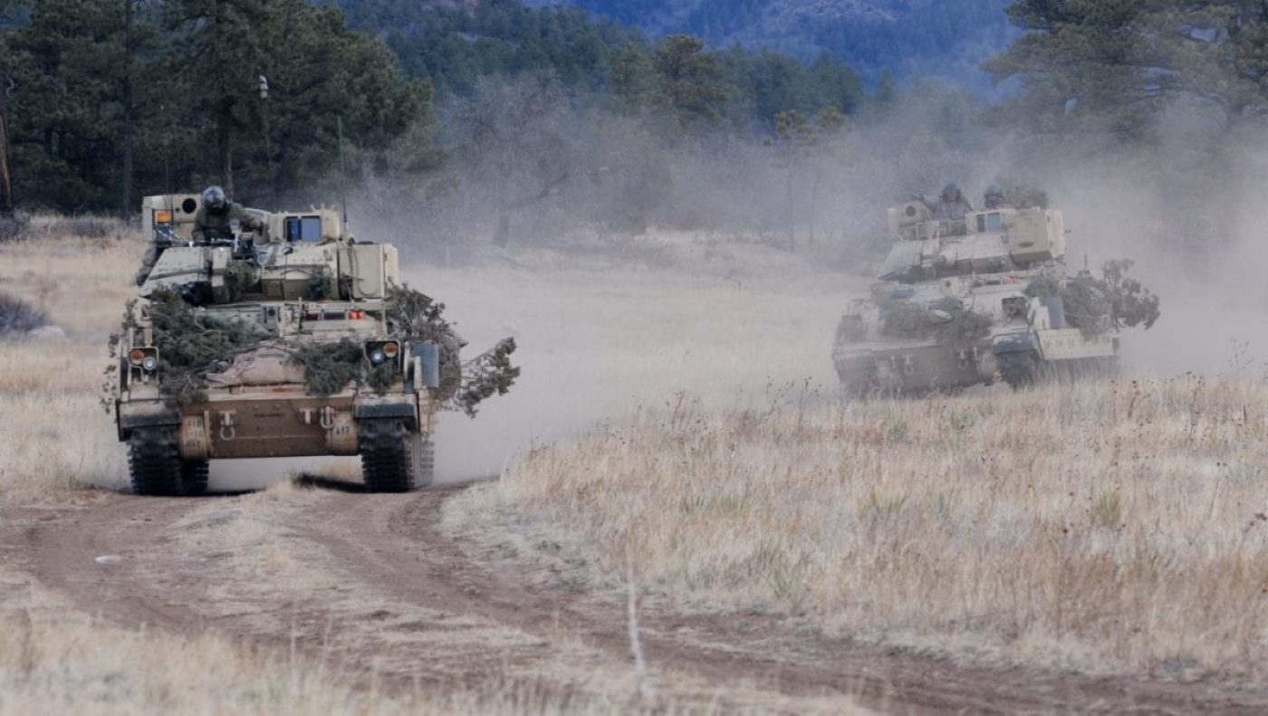 Soldiers of 1st Squadron, 10th Cavalry Regiment, 2nd Brigade Combat Team, 4th Infantry Division drive their M3A3 Bradley Fighting Vehicles to reach a phase line where they will move into a defensive posture during platoon scout training. The Army anticipates that the Intelligent Tracker – a new technological capability developed by a team of Naval Surface Warfare Center Dahlgren Division (NSWCDD) scientists and engineers – will enhance automation for direct fire weapon systems while increasing the speed of operator engagements against targets. The automation applies to a wide range of applications to include the 30mm main gun on a Bradley Fighting Vehicle. (U.S. Army photo by Staff Sgt. Andrew Porch/Released)