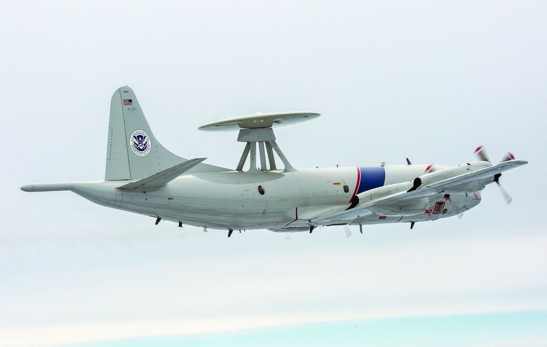 A CBP Air and Marine Operations (AMO) P-3 Orion surveillance aircraft in flight. About a third of JIATF South's flight hours take place aboard AMO P-3s, but they account for half of drug seizures. (CPB photo)