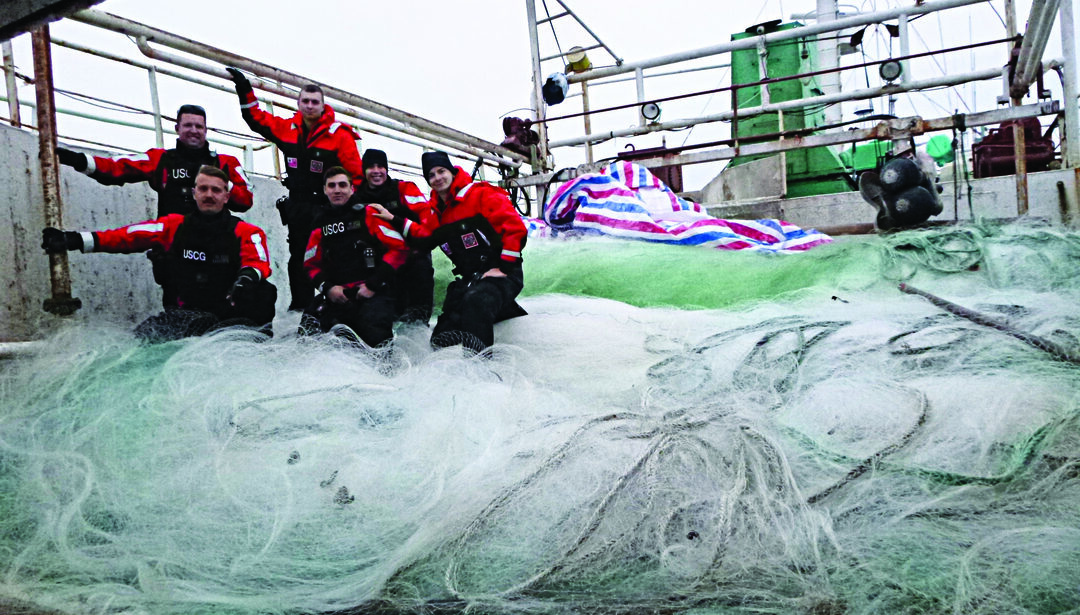 Coast Guard Cutter Alex Haley's boarding team stands a top a 5.6-mile-long driftnet found aboard the fishing vessel Run Da in the North Pacific Ocean, June 16, 2018. The Alex Haley crew detained the Run Da after it was suspected of illegal, unreported, and unregulated fishing activity in international waters 860 miles east of Hokkaido, Japan. (U.S. Coast Guard photo by Lt. Jerry Wong)