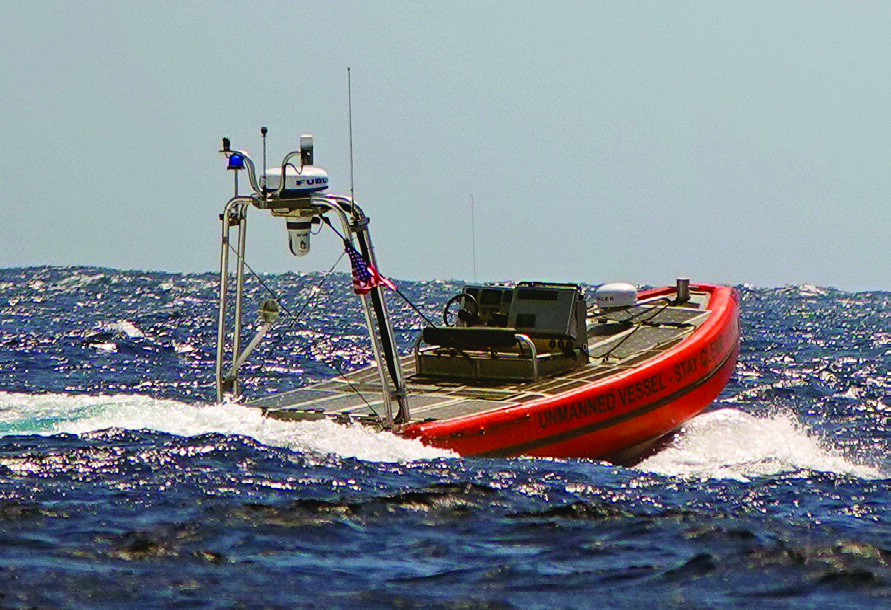 """""""The Watcher,"""" a Coast Guard prototype unmanned surface vehicle, performs a test off Oahu, Hawaii, Oct. 7, 2020. The vessel is based on the Coast Guard's cutter boat-large. (U.S. Coast Guard photo courtesy of The Coast Guard Research and Development Center)"""