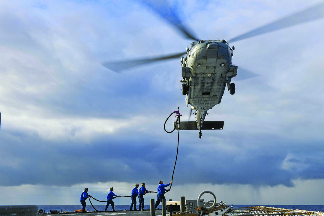 U.S. Coast Guard personnel assigned to U.S. Coast Guard Legend-class cutter Munro (WMSL 755) conduct a helicopter in-flight refuel (HIFR) with a U.S. Navy MH-60S Sea Hawk helicopter. (U.S. Navy photo by Mass Communication Specialist 3rd Class Madysson Annie Ritter)