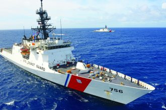 The crews of the Coast Guard Cutters Kimball (WMSL 756) and Midgett (WMSL 757) transit off Honolulu, Aug. 16, 2019. The cutters are two of the newest to join the Coast Guard fleet and are both homeported in Hawaii. (U.S. Coast Guard photo by Petty Officer 3rd Class Matthew West)