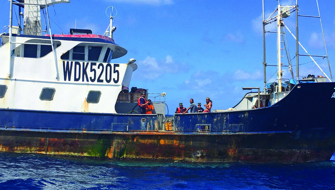 A boat crew from USCGC Joseph Gerczak (WPC 1126), along with NOAA Fisheries and American Samoa Marine Police members, approaches a fishing vessel in the American Samoa exclusive economic zone to conduct a boarding to ensure compliance with safety and fishing regulations, Aug. 9, 2019. The Central and Western Pacific is home to more than 60 percent of the world's commercially harvested tuna, and the United States works cooperatively in the Pacific to protect living marine resources. (U.S. Coast Guard photo by Petty Officer 3rd Class Scott Sabatini)