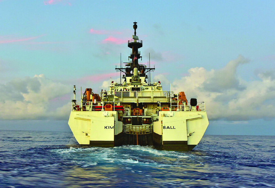 Coast Guard Cutter Kimball (WMSL 756) plies the Pacific Ocean after launching a small boat from its stern ramp near Hawaii during its final pre-commissioning sea trials Aug. 11, 2019. The ship, the seventh National Security Cutter to be acquired by the Coast Guard, entered service in a dual-commissioning ceremony with Coast Guard Cutter Midgett (WMSL 757), the eighth NSC, at their new homeport in Honolulu Aug. 24, 2019. (U.S. Coast Guard photo by Chief Petty Officer John Masson)