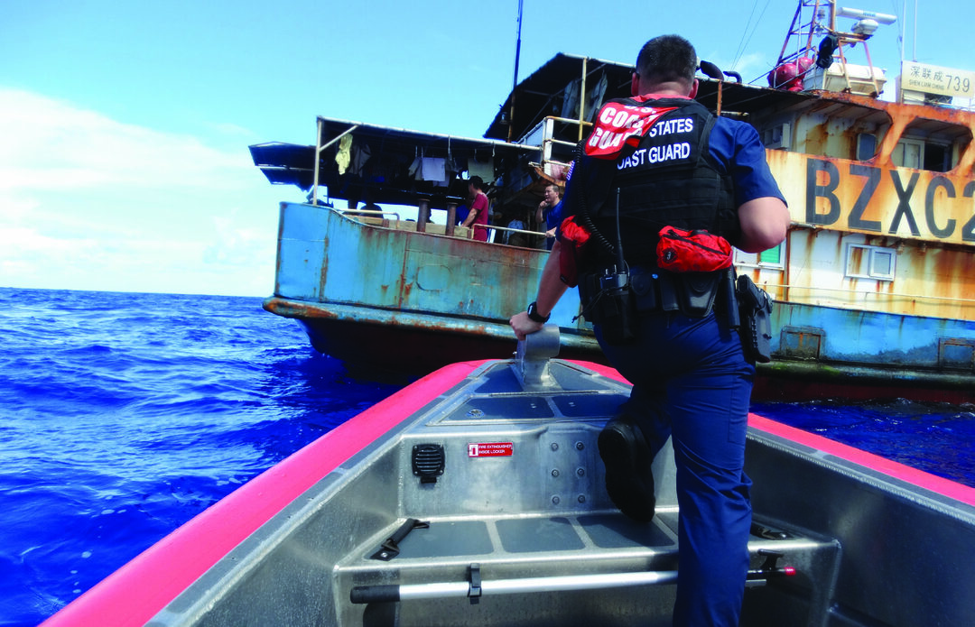 The crew of the Coast Guard Cutter Oliver Berry boards a fishing vessel during a round-trip patrol from Sept. 12 to Oct. 27, 2020, from Hawaii to Guam, covering a distance of approximately 9,300 miles during the journey. The crew sought to combat illegal fishing and other maritime threats across the Pacific to protect United States and partner nations' resource security and sovereignty. (U.S. Coast Guard photo courtesy of the CGC Oliver Berry)