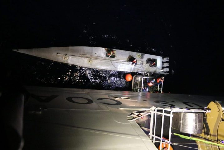 Crew members from the U.S. Coast Guard Cutter Munro (WMSL 755) take possession of a low-profile boat Jan. 28, 2021, in the Eastern Pacific Ocean. The crew of the Munro intercepted the suspected drug smuggling boat and recovered approximately 1,550 kilograms of suspected cocaine. (U.S. Coast Guard photo)