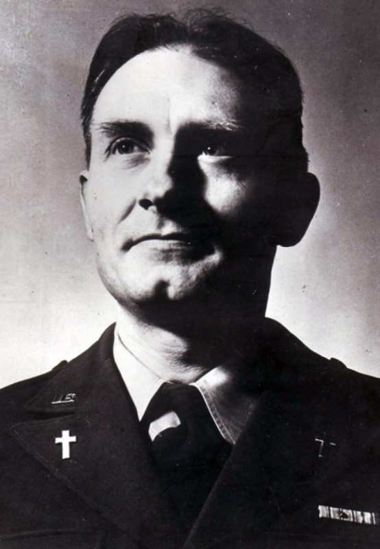 Chaplain (Capt.) Emil J. Kapaun posing for a portrait, the symbol of the cross prominently displayed on his lapels. (Courtesy photo - U.S. Army)