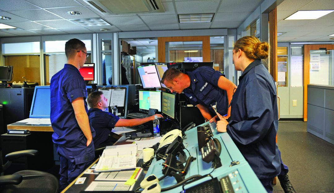 The operations specialists on duty listen intently to a radio call in Coast Guard Sector Southeastern New England's command center on Aug. 12, 2016. At the push of a button, a DSC distress call immediately and automatically transmits an exact GPS position and vital vessel information to the Coast Guard sector command centers, like this one in Massachusetts, and other DSC-equipped vessels. The system has playback capabilities for all communications, which can be important during rescue operations or follow-up investigations. (U.S. Coast Guard Photo by Petty Officer 3rd Class Nicole J. Croll)